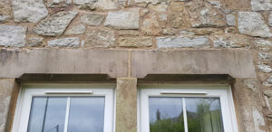 Photograph showing lime pointing to stonework around windows