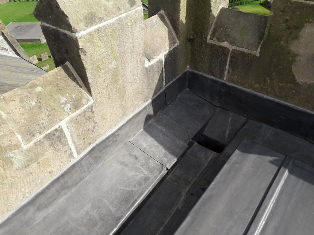 lead gutter within church tower roof top
