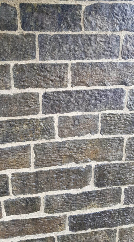 stone wall of church with new lime pointing