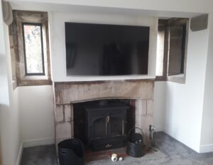 stone fireplace with water staining
