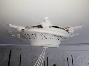 ornate ceiling rose pulling away from ceiling