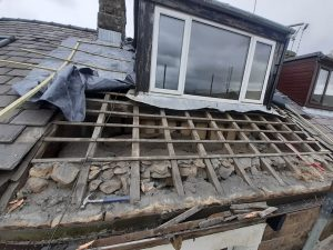 dormer window with slates underneath removed