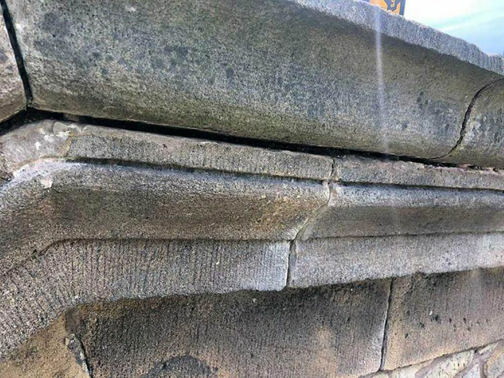Coping joints raked out prior to repointing