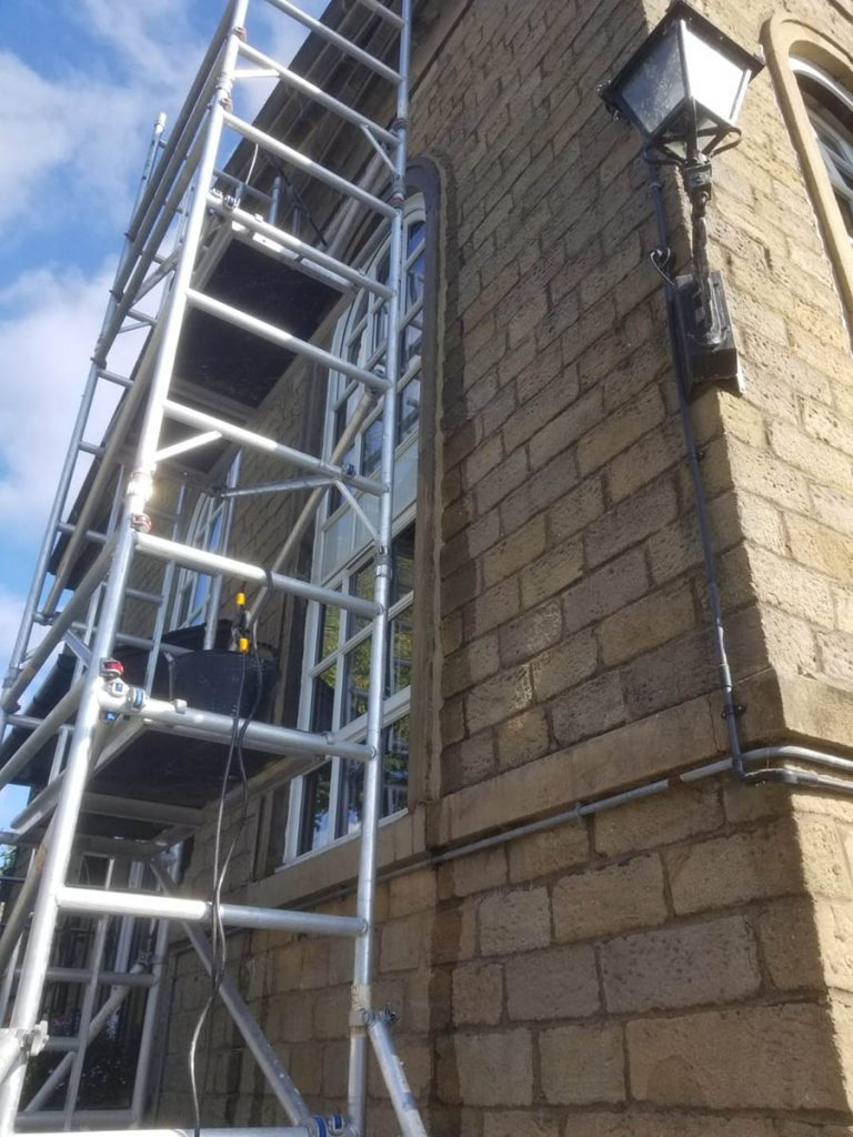 Scaffold access during arched window limework